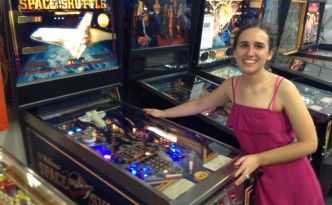 M with her pinball machine, Space Shuttle